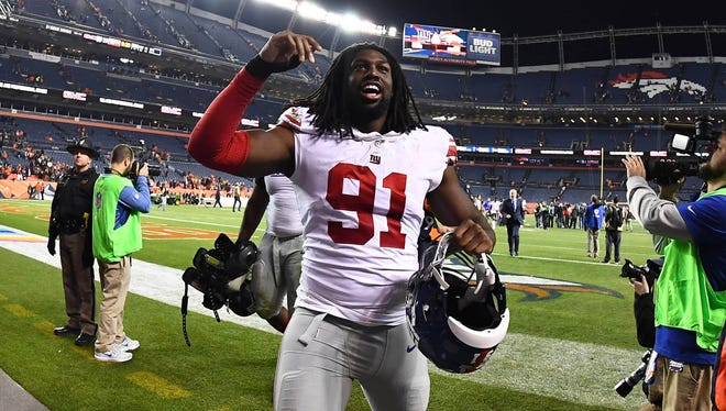 Giants rookie defensive end Avery Moss celebrates Sunday's 23-10 upset victory over the Broncos at Sports Authority Field at Mile High in Denver.
