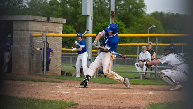 Oak Creeks Senior Alex Binales hits a three run home run for his team during the game against West Allis Hale on May 25, 2018.
