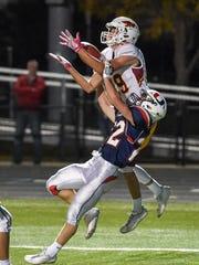 Ankeny's Brody Brecht (19) catches a touchdown pass
