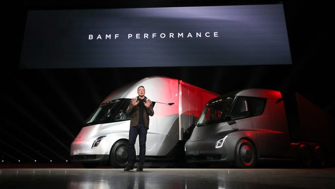 Elon Musk unveils his new Tesla Semi trucks in Los Angeles Thursday. The acronym can't be spelled out here, but think fast.