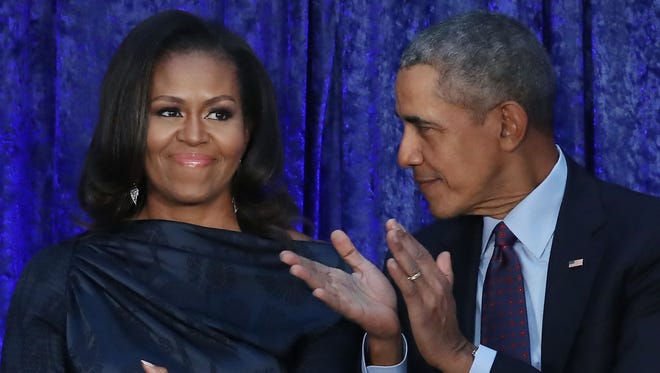 Former President Barack Obama, right, and his wife, Michelle, are in talks with Netflix to produce a series of high-profile shows, according to news reports.