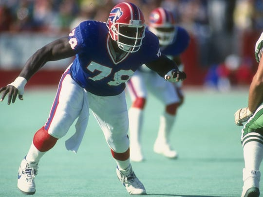 Defensive lineman Bruce Smith of the Buffalo Bills rushes the New York Jets line during a game at Rich Stadium in Orchard Park on Oct. 21, 1990. The Bills won the game, 30-27.