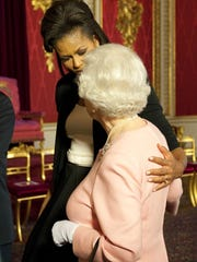 Former first lady Michelle Obama with Queen Elizabeth