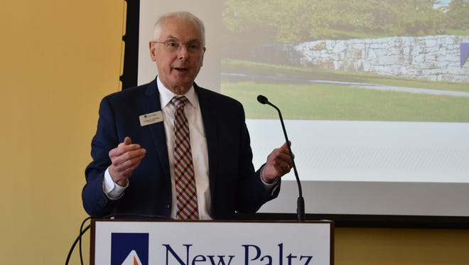 SUNY New Paltz Donald Christian addresses business owners at the New Paltz Regional Chamber of Commerce's monthly luncheon.