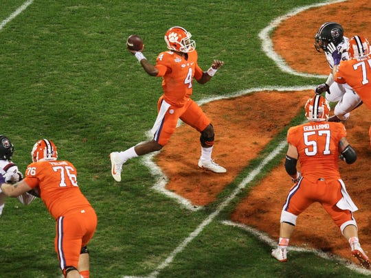 Clemson quarterback Deshaun Watson (4) passes with protection from linemen offensive lineman Sean Pollard, left, center Jay Guillermo (57), and offensive lineman Mitch Hyatt (75) during the first quarter on Saturday at Memorial Stadium in Clemson.
