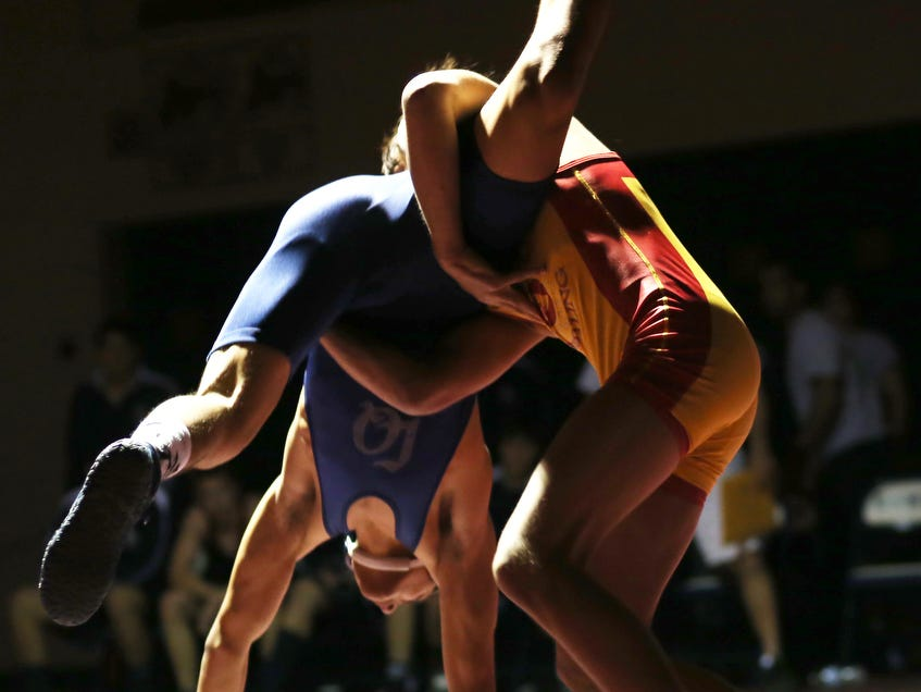 Palm Desert's Anthony Mantanona and La Quinta's Joseph Valdez square off in the 138 lb class as rivals Palm Desert takes on La Quinta in DVL wrestling at La Quinta High, Wednesday, January 29, 2014.