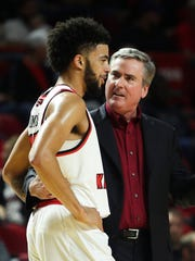 Western Kentucky guard Darius Thompson (15) talks to