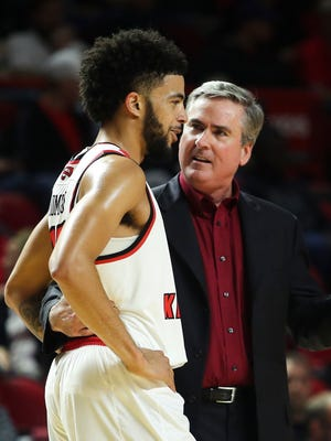 Western Kentucky guard Darius Thompson (15) talks to head coach Rick Stansbury in an NCAA college basketball exhibition game against Campbellsville in Bowling Green, Ky., Wednesday, Nov. 1, 2017. (Austin Anthony/Daily News via AP)