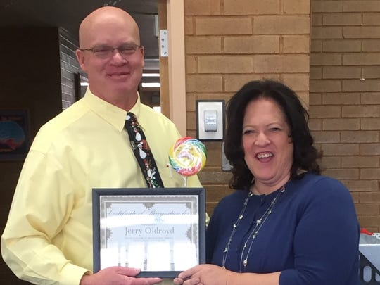 Jerry Oldroyd is presented with the Utah PTA/USSA Administrator of the Year Award by ICSD Superintendent Shannon Dulaney on Dec. 19, 2016.