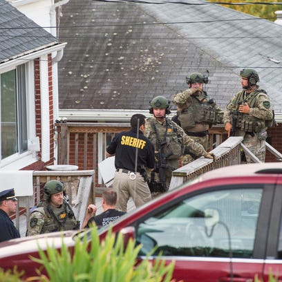 Police stand outside a Pierce Avenue residence in Endwell
