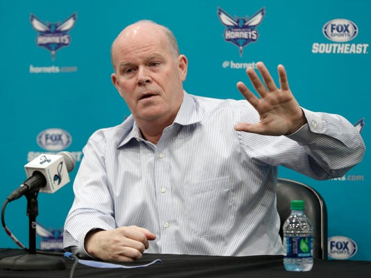 """Charlotte Hornets head coach Steve Clifford speaks to the media during an end of season news conference for the NBA basketball team in Charlotte, N.C., Wednesday, April 11, 2018. The Hornets wrapped up what new GM Mitch Kupchak said has to be considered a """"disappointing"""" season. Now questions loom about the team's future, including whether Kemba Walker or Dwight Howard will be traded, the future of coach Steve Clifford and if owner Michael Jordan decides to embark on a major rebuilding process. (AP Photo/Chuck Burton)"""