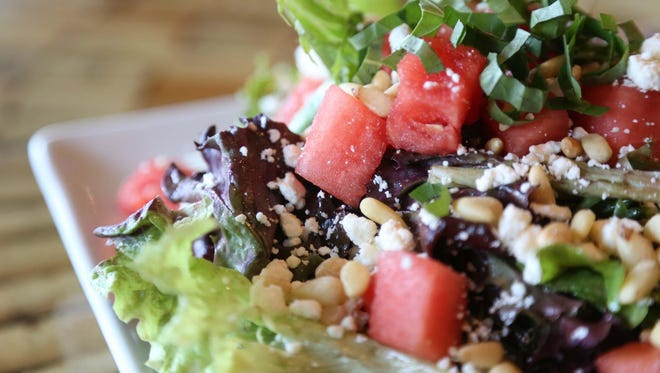 The watermelon salad with mixed greens, feta cheese, basil, pine nuts and balsamic vinaigrette at Vesta on Monday, June 8, 2015, in Coralville.