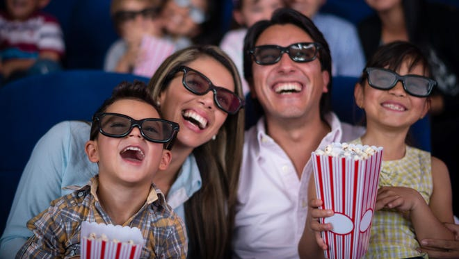 Family watching a 3D movie at the cinema