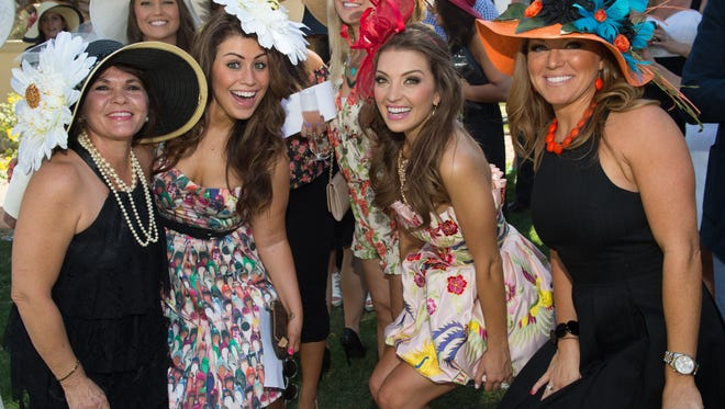These women show off their fashionable hats and spring outfits at Bourbon Steak's annual Kentucky Derby party.
