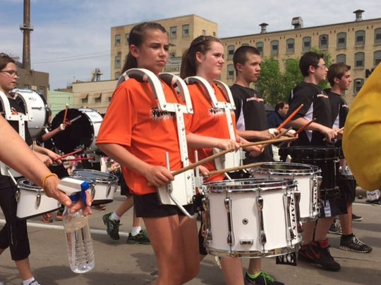 The West De Pere Middle School drumline plays during the 2014 De Pere Kiwanis Memorial Day Parade.