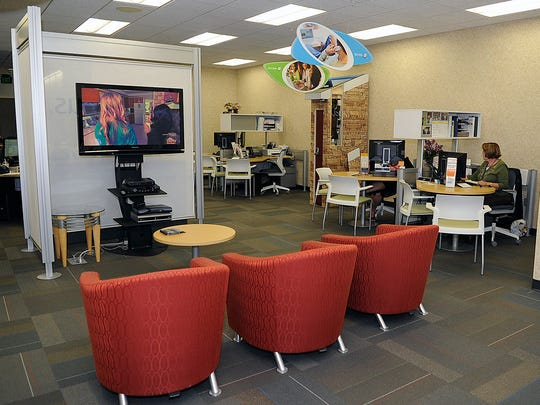 The customer service lounge area and customer service area at Solarus Friday Sept 5, 2014.