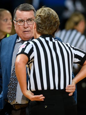 Middle Tennessee head coach Rick Insell talk with a referee after the first half of their game against Vanderbilt at Memorial Gymnasium Friday, Nov. 10, 2017 in Nashville, Tenn.