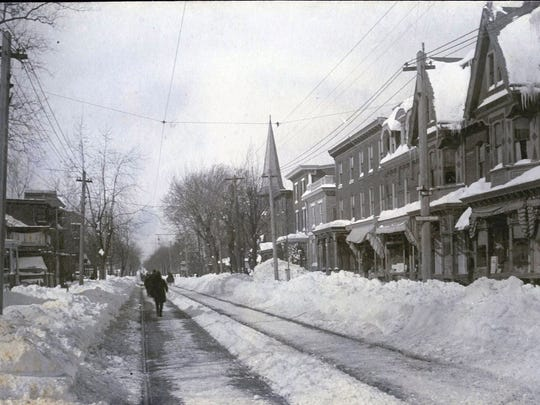 A view of Market Street looking north from 10th Street in Wilmington after the 1888 Blizzard. The trolley tracks are cleared.