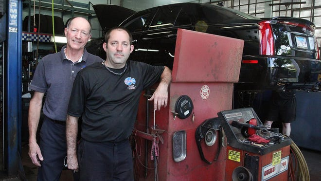 Tim Heiden, left, and his son, Jeremy Heiden, stand in the shop at Tim's Auto on Wednesday, June 17, 2020, in Freeport. The father and son have worked together for a decade.