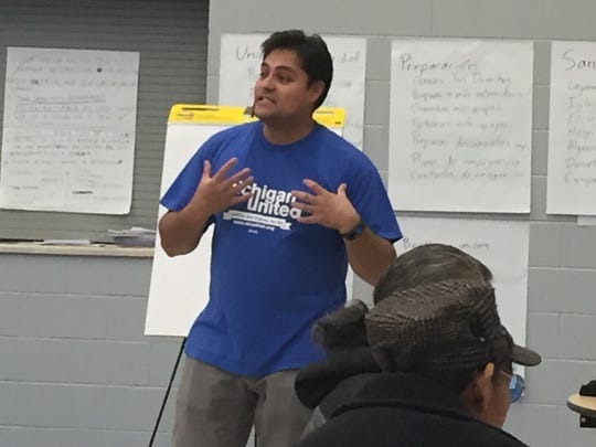 Adonis Flores, 28, of Michigan United talks to immigrants on Nov. 19, 2016,  in Hope of Detroit Academy, at an educational workshop about immigrant rights and concerns.