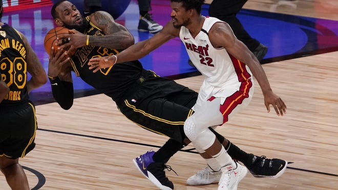 Heat guard Jimmy Butler (right) out-dueled Lakers forward Lebron James to force a Game 6 on Friday night.
