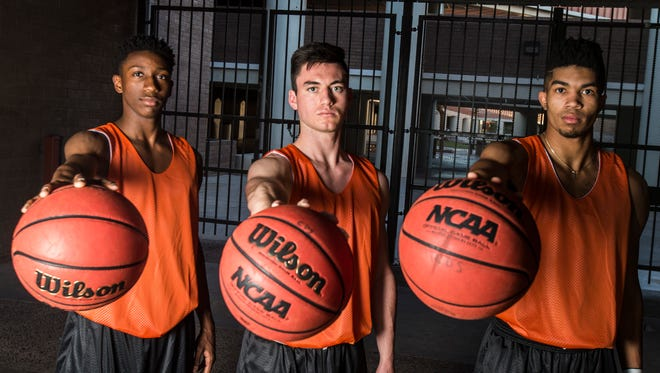 (Left to right) Corona del Sol's Saben Lee, Alex Barcello and Tyrell Henderson look to lead the team back to another State Championship at Corona del Sol in Tempe.