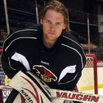 Robin Lehner holds the Calder Cup for fans outside of the Broome County Veterans Memorial Arena following the City of Binghamton's parade in honor of the team's Calder Cup victory in 2011.