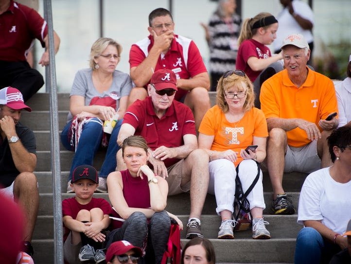 Tennessee fans sit among Alabama fans outside of the