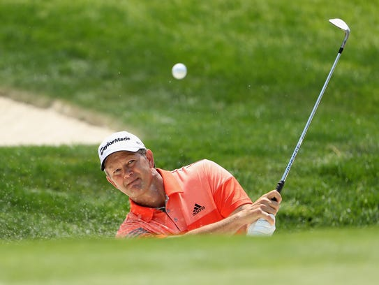 Retief Goosen of South Africa plays his shot out of