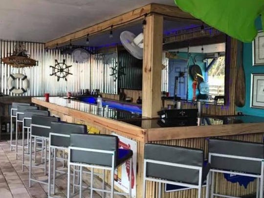 The outdoor bar at Shark Bar & Grill in Fort Myers