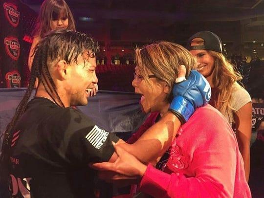 """Baby"" Joe Taimanglo celebrates with his mother, Josephine"