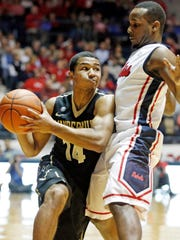 Vanderbilt guard Carter Josephs (14) tries to get around the defense of Mississippi guard Derrick Millinghaus (3) in the second half of an NCAA college basketball game in Oxford, Miss., Saturday, March 8, 2014. Mississippi won 65-62. (AP Photo/Rogelio V. Solis)