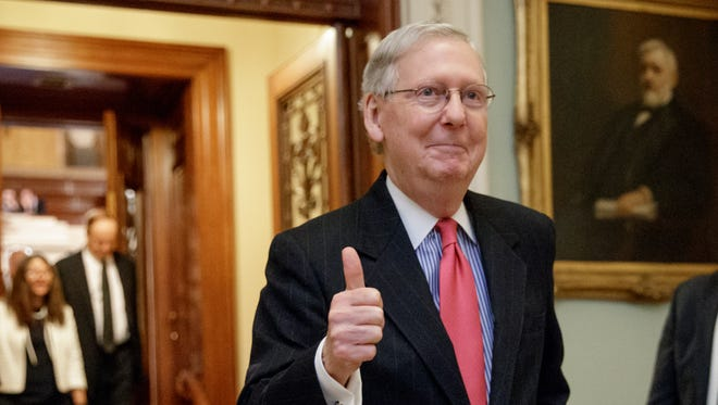Senate Majority Leader Mitch McConnell of Ky. signals a thumbs-up as he leaves the Senate chamber on Capitol Hill in Washington, Thursday, April 6, 2017, after he led the GOP majority to change Senate rules and lower the vote threshold for Supreme Court nominees from 60 votes to a simple majority in order to advance Neil Gorsuch to a confirmation vote.