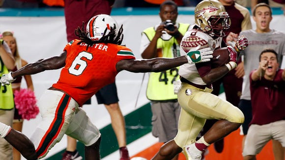 Florida State wide receiver Kermit Whitfield (8) runs