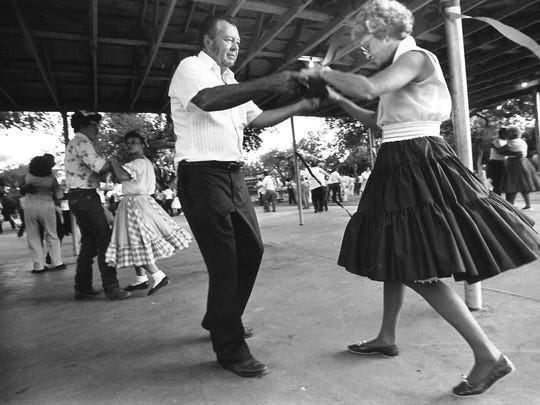 Dancers scoot the evening away at a reunion in June 1984 at Kirby Park.