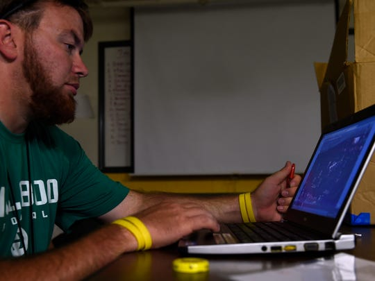 Hillsboro assistant coach Dustin Lopez uses video software