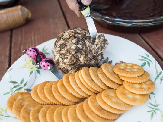 A cricket-covered cheese ball is served with crackers at Hope Farms Wednesday, April 13, 2016. Brave eaters learned the basics of eating bugs while trying out fried mealworms and cricket flour muffins.