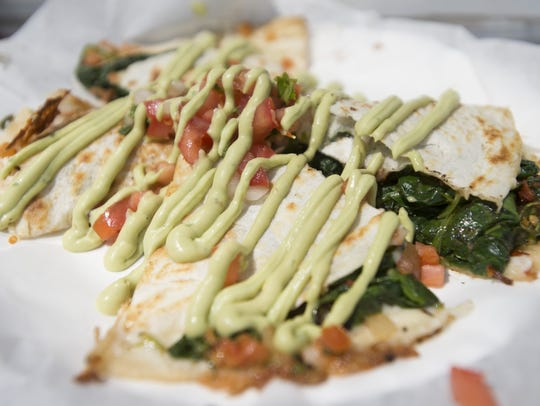 Spinach quesadillas are served from the Taco Stop trailer