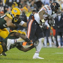 Chicago Bears running back Matt Forte (22) drags along Green Bay Packers linebackers Nick Perry and Nate Palmer during their game  in November.
