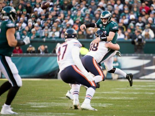 Eagles quarterback Carson Wentz (11) narrowly gets