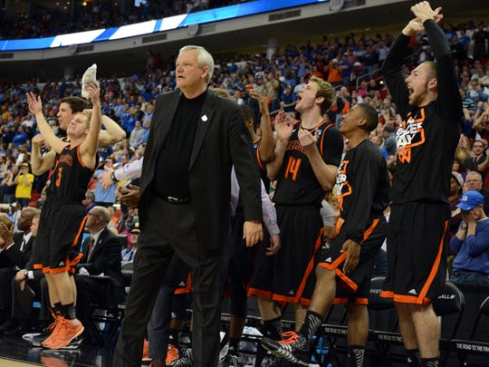 Mercer Bears head coach Bob Hoffman and the Mercer Bears bench reacts in the closing seconds against the Duke Blue Devils in a men's college basketball game during the second round of the 2014 NCAA Tournament at PNC Arena.