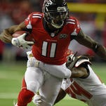 Falcons wide receiver Julio Jones caught 136 passes in 2015, tying him for the second-most receptions in a season in NFL history.