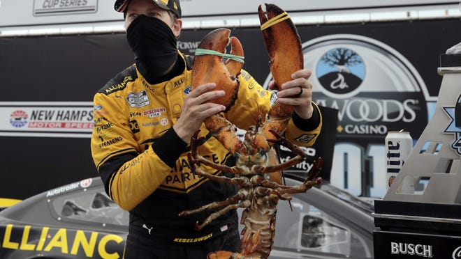 Brad Keselowski holds a giant lobster to celebrate his victory in last Sunday's NASCAR Cup Series race at the New Hampshire Motor Speedway in Loudon, N.H.