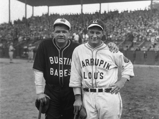 This October 1927 file photo shows New York Yankees stars Babe Ruth, left, and Lou Gehrig during an exhibition game.