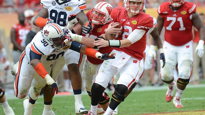 Wisconsin quarterback Joel Stave, shown avoiding a sack in the second half against the Auburn Tigers in the Outback Bowl in January, returns for the Badgers.