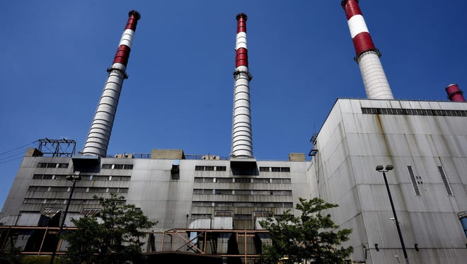 Ravenswood Generating Station on Long Island, uses natural gas, fuel oil and kerosene to power its boilers. New climate rules include the requirement that carbon emissions be reduced 32 percent by the year 2030, relative to 2005 levels.