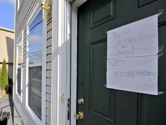 A sign on the door of the house where Harrisburg terrorism suspect Jalil Aziz lived.