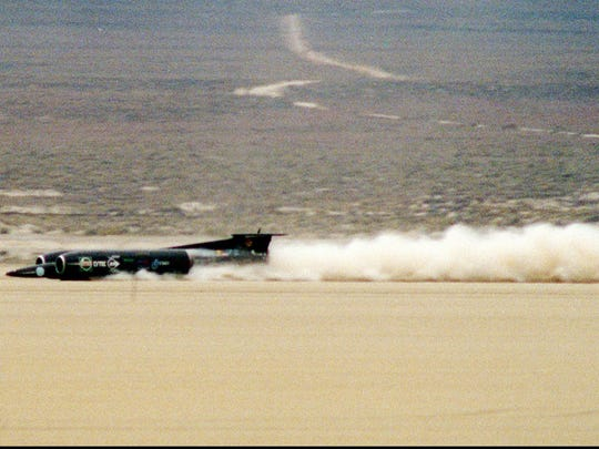 Thrust SSC speeds across the Black Rock Desert about 100 miles north of Reno, Nevada during the first of two runs Thursday, Sept. 25, 1997 which allowed Andy Green to set a new land speed record of more than 700 miles per hour. The old record, also held by the British, was 633 miles per hour set on this same desert 14 years ago by Richard Noble, who is in charge of this year's project. (AP Photo/Reno Gazette-Journal, Marilyn Newton)