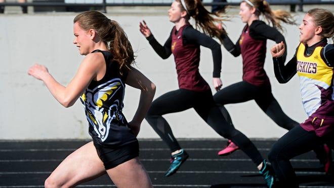 Zoe Delaney of Winnett-Grass Range (foreground) is one of the best sprinters in Montana.