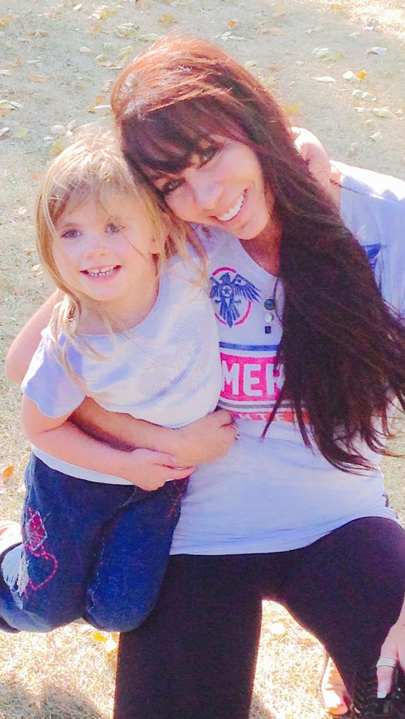 Tracy Urich, Chipps' mother, poses with her granddaughter,
